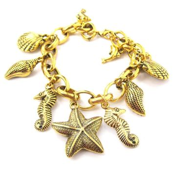 Sea Creatures Themed Charm Bracelet in Gold: Starfish Seahorse Seashell Dolphins