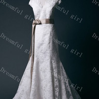 Ivory dress with champagne sash and bow lace with v-neck wedding dress