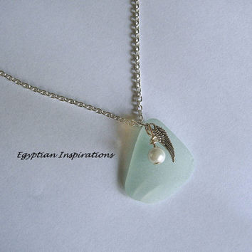 Aqua sea glass necklace with angel wing and pearl. Beach glass jewelry.