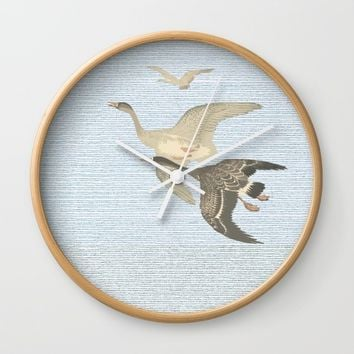 Nothing to match the flight of wild birds flying Wall Clock by anipani