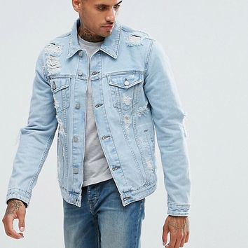 ASOS Denim Jacket With Rips In Extreme Light Wash at asos.com