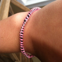 Black and pink silver beaded friendship bracelet with silver clasp