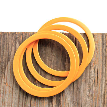 Vintage Bakelite Bangle Bracelets -  Lot of 4 Orange Nesting Bangles, Set of Costume Jewelry / Early Plastic Tangerine Set
