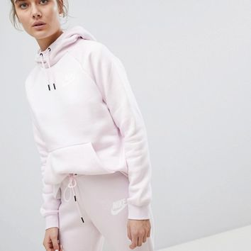 Nike Rally Pullover Hoodie In Pearl Pink at asos.com