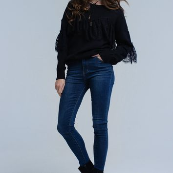Black sweater with lace ruffles