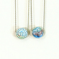 Reversible sun and moon necklace with blue celestial crescent moon pendant