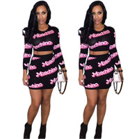 Black Moschino Long Sleeve Cropped Top and Mini Skirt