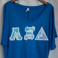 Royal Bella Half Sleeve T-Shirt With Alpha Xi Delta Lilly on Metallic White