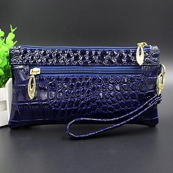 Women Embossed Patent Leather Wristlet