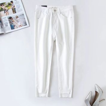 FREE SHIPPING Summer slim front short back long feet slit stretch white jeans small feet pants