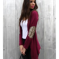 Not Your Girlfriend Cardi - Mulberry cardigan featuring gold sequin elbow patches