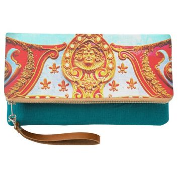 Gold face sparkly carousel photo fold-over clutch
