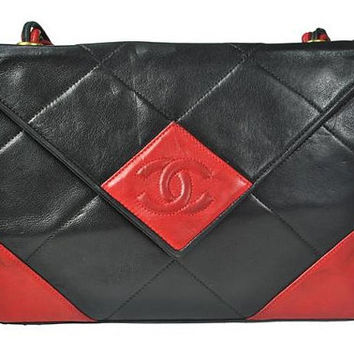 80's Vintage CHANEL red and black lambskin shoulder purse with multi-string shoulder strap. Rare bag from Chanel.