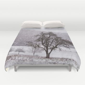 Old pear tree on a wintery meadow Duvet Cover by Pirmin Nohr