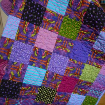 African fabric baby quilt, Purple Pink toddler bedding, patchwork jewel tone nursery, bright baby quilt, handmade quilted blanket, abstract
