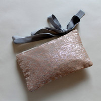 Apricot silk wrislet, metallic silk clutch,