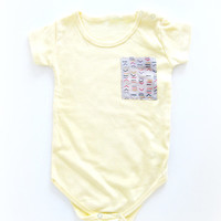 Baby Onesuit with trendy Aztec fabric pocket