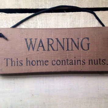 Funny Sign. Funny Gift. This home contains nuts.