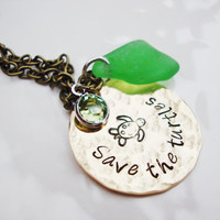 Save the turtles brass necklace with green sea glass and peridot crystal charm