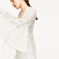 LACE BLOUSE WITH BELL SLEEVES DETAILS
