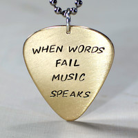 When words fail music speaks bronze guitar pick pendant