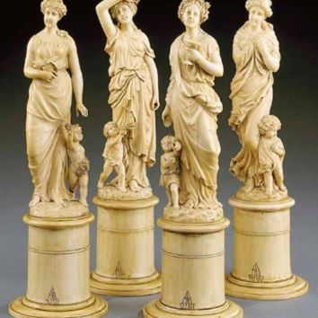 A set of French carved-ivory figures of the four seasons , CIRCA 1885