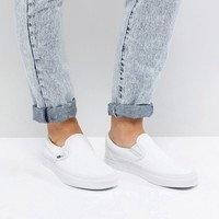 Vans Slip On Sneakers In White at asos.com