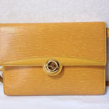 Vintage Louis Vuitton rare yellow epi shoulder purse with gold tone turn lock closure.