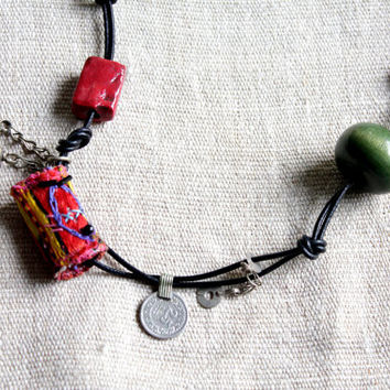 Art Artisan Necklace with Beads and metal charms Asian Elements and Hand Stitched Embroidered.