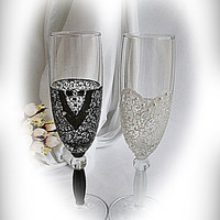 Black and white wedding glasses. Wedding champagne glasses. Bride and groom married. Mr and Mrs glasses