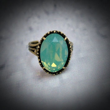 Pacific Opal Cushion Cut Oval Adjustable Ring by LillieJJewellery