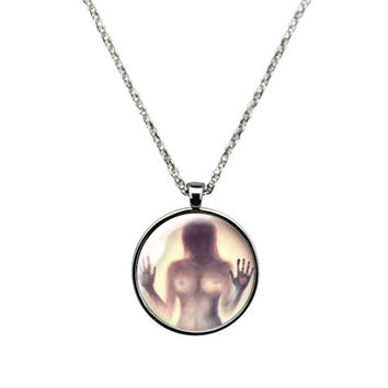 Outsider series Girl trapped behind glass, Jewelry stainless steel casing crystal glass pendant with embedded girl trapped behind glass.
