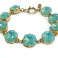 Catherine Popesco Gold Plated Pacific Blue Swarovski Crystals Link Bracelet