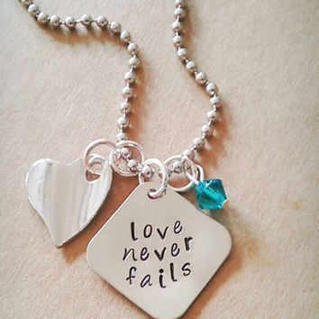 """Hand Stamped """"Love Never Fails"""" Necklace"""