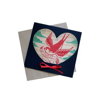 Die cut wood heart card comes in it's own cardstock holder, packaged in a clear sleeve.