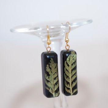 "Earrings ""green leaves"" Long earrings made of epoxy resin jewelry, small green leaves on a black background."