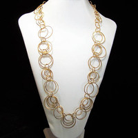 Joan Rivers Necklace, Gold Tone Intertwined Wire Circles, 28-31 Inches Long, Textured Surface, Statement Necklace, Signed 717
