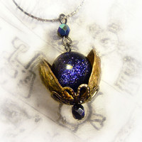 Universe in a nutshell pendant made with real pistachio shells and blue sandstone