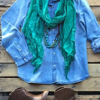 Our Please Don't Leave Me Top - Denim would be perfect for all you country girls! It's a long sleeve denim shirt with fading and distressing. Collar and pearl buttons all the way down the front, pockets, and sleeves. Sleeves can also be rolled up.