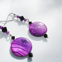 Purple earrings in a round violet shell  mother of pearl with black and purple beads