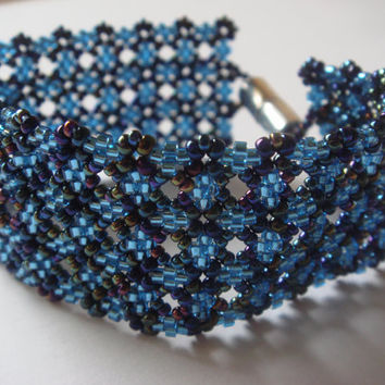 Blue beaded bracelet in peyote stitch.