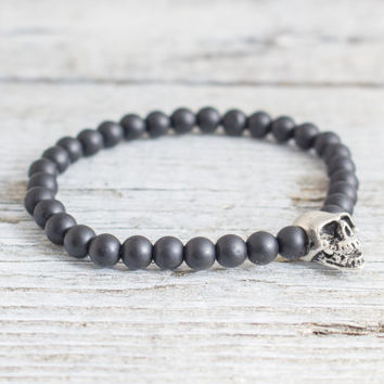 Matte black onyx beaded stretchy bracelet with a Skull, custom made yoga bracelet, mens bracelet, womens bracelet