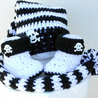 Crocheted baby pixie hat and booties black and white skull Halloween set.