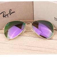 Ray-ban sells shades for casual ladies with shades on beach