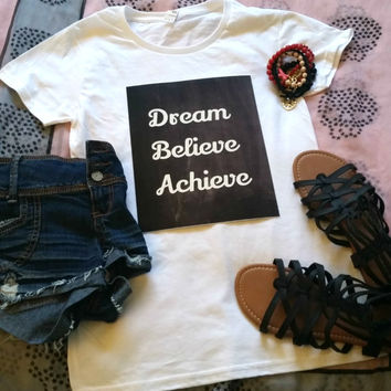 Dream Believe Achieve quote t-shirt available in white or black size s, med, large, and Xl for juniors girls and women