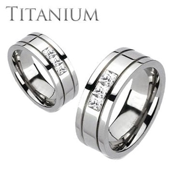 Oxygen - A trio of square cut cubic zirconia grooved band titanium his and hers ring