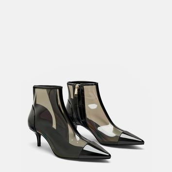 HEELED VINYL ANKLE BOOTS