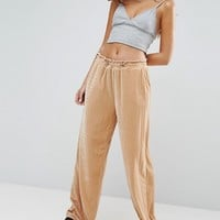 ASOS Wide Leg Velvet Trousers with Elastic Cord at asos.com