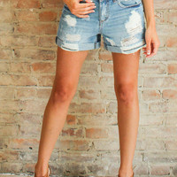 Off Duty Distressed Denim Shorts