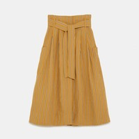 VOLUMINOUS SKIRT WITH BOW DETAIL DETAILS